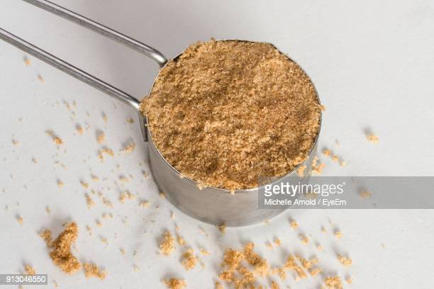 High Angle View Of Brown Sugar In Measuring Cup