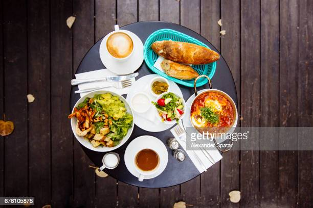 high angle view of brunch served on the round table - tel aviv stock pictures, royalty-free photos & images