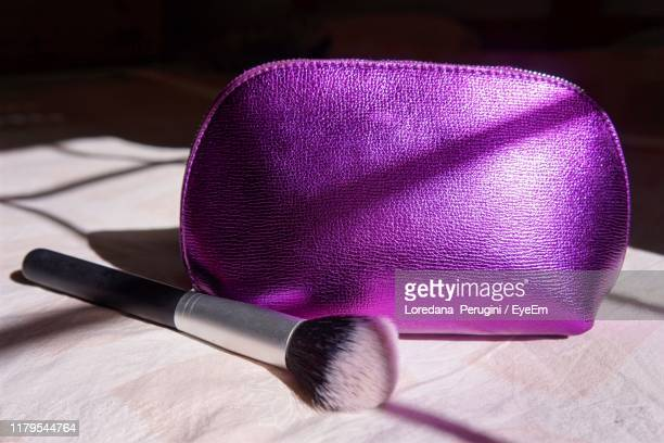 high angle view of brush and bag on table - loredana perugini stock pictures, royalty-free photos & images