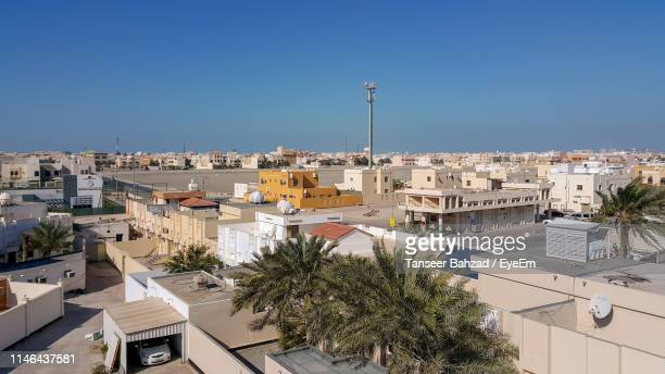 high angle view of building in city against sky - manama stock pictures, royalty-free photos & images
