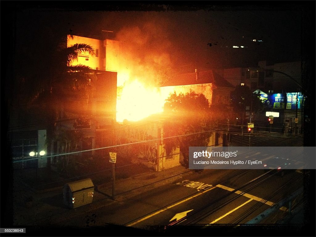 High Angle View Of Building Under Fire At Night : Stock Photo