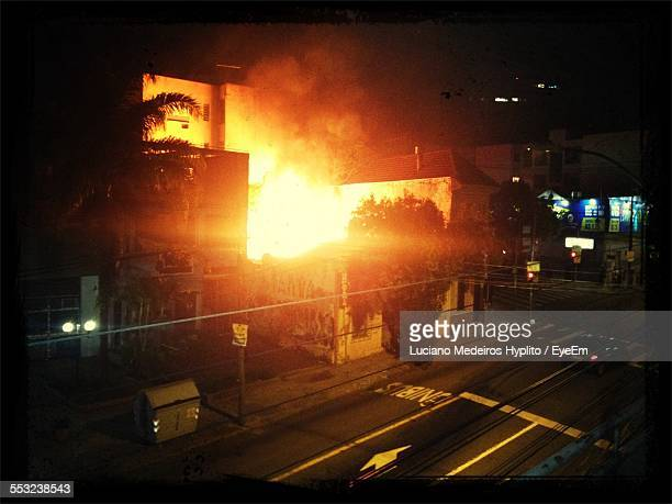 High Angle View Of Building Under Fire At Night