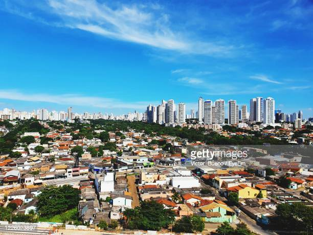 high angle view of buildings against blue sky - goiania imagens e fotografias de stock