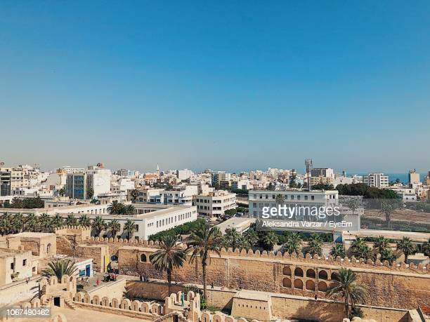high angle view of buildings against clear blue sky - sousse stock pictures, royalty-free photos & images