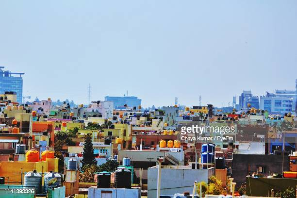 high angle view of buildings against clear blue sky - bangalore stock pictures, royalty-free photos & images