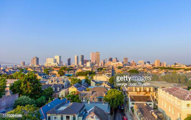 high angle view of buildings against clear blue sky - new orleans stock pictures, royalty-free photos & images