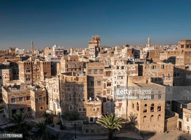 high angle view of buildings against clear blue sky - sanaa stock pictures, royalty-free photos & images