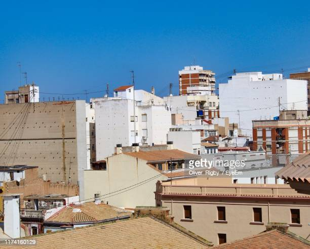 high angle view of buildings against clear blue sky - castellon de la plana stock pictures, royalty-free photos & images