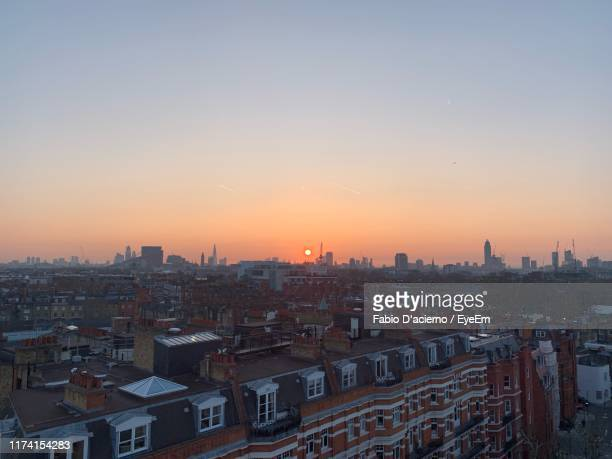 high angle view of buildings against clear sky at sunset - panorama stock pictures, royalty-free photos & images