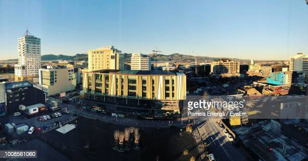 high angle view of buildings against clear sky - christchurch stock pictures, royalty-free photos & images
