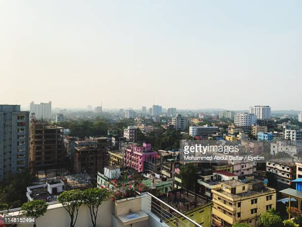 high angle view of buildings against clear sky - bangladesh stock-fotos und bilder