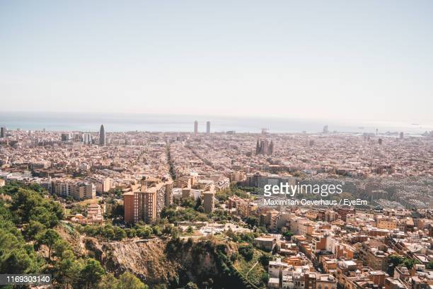 high angle view of buildings against clear sky - barcelona spanien stock-fotos und bilder