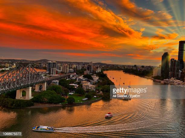 high angle view of buildings against cloudy sky during sunset - brisbane stock pictures, royalty-free photos & images