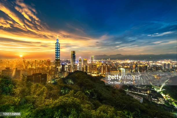 high angle view of buildings against cloudy sky - taipei stock pictures, royalty-free photos & images