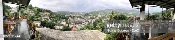 high angle view of buildings against cloudy sky - kandy kandy district sri lanka stock photos and pictures