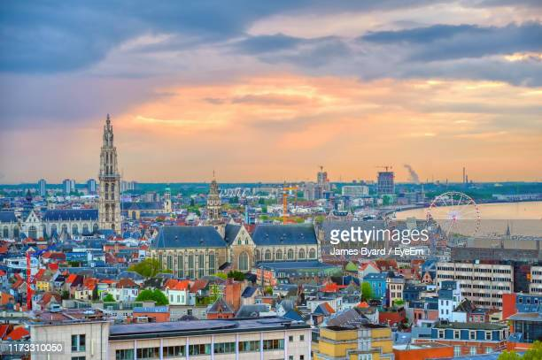 high angle view of buildings against cloudy sky - antwerpen stad stockfoto's en -beelden