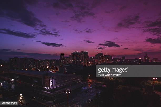 High Angle View Of Buildings Against Purple Sky At Dusk In City