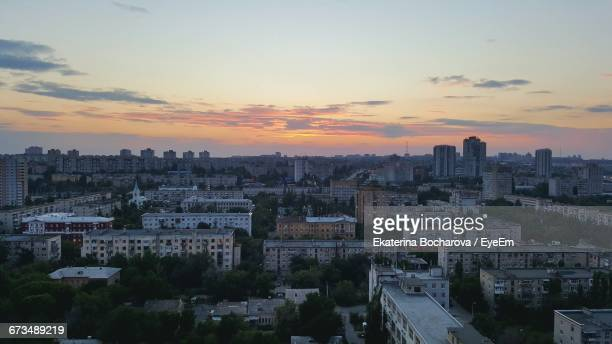 high angle view of buildings against sky at dusk in city - volgograd stock pictures, royalty-free photos & images