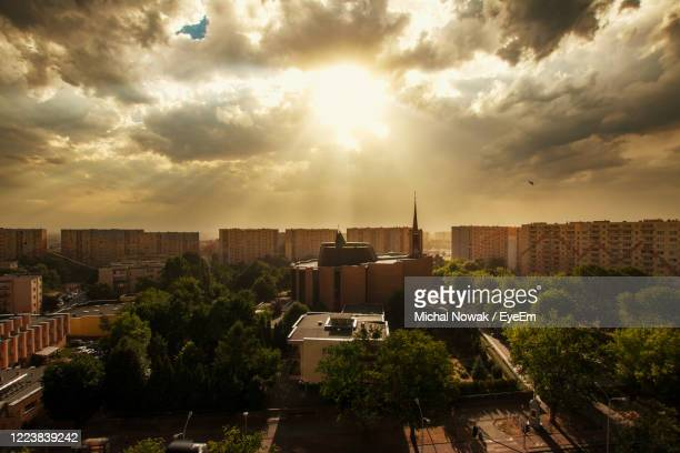 high angle view of buildings against sky at sunset - golden hour stock pictures, royalty-free photos & images