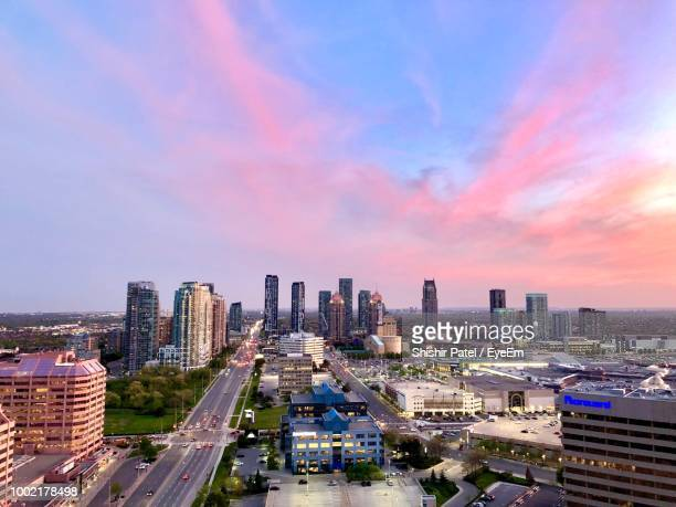 high angle view of buildings against sky during sunset - mississauga stock pictures, royalty-free photos & images