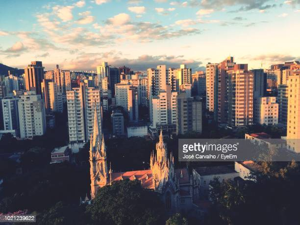 high angle view of buildings against sky during sunset - belo horizonte stock pictures, royalty-free photos & images