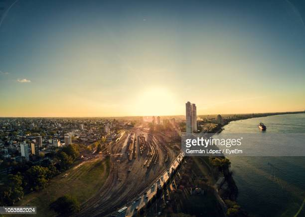 high angle view of buildings against sky during sunset - argentine photos et images de collection