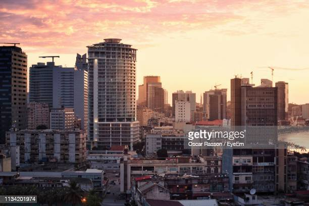 high angle view of buildings against sky during sunset - angola stock pictures, royalty-free photos & images