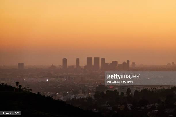 high angle view of buildings against sky during sunset - smog stock pictures, royalty-free photos & images