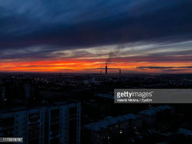 high angle view of buildings against sky during sunset - nikitina stock pictures, royalty-free photos & images