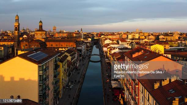 high angle view of buildings against sky during sunset - milan stock pictures, royalty-free photos & images