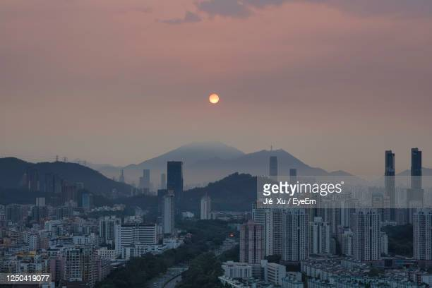 high angle view of buildings against sky during sunset - shenzhen stock pictures, royalty-free photos & images