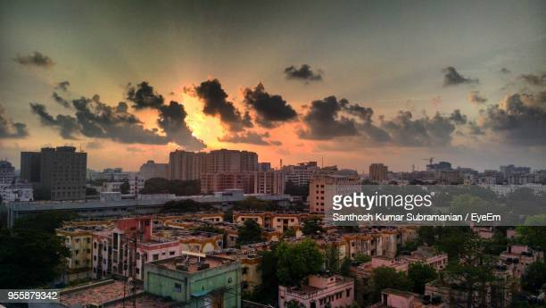high angle view of buildings against sky during sunset - chennai stock pictures, royalty-free photos & images
