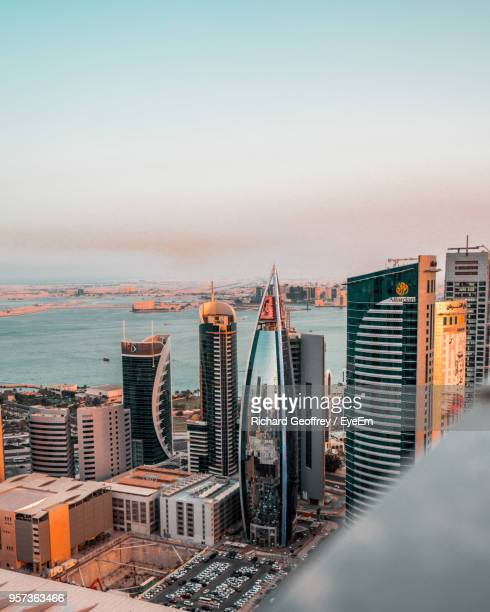 high angle view of buildings against sky during sunset - doha stockfoto's en -beelden