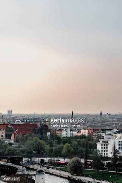 high angle view of buildings against sky during sunset - central berlin stock photos and pictures