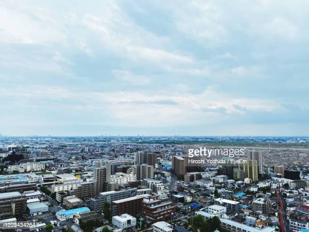 high angle view of buildings against sky in city - 埼玉県 ストックフォトと画像