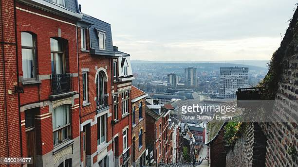 high angle view of buildings against sky in city - liege stock pictures, royalty-free photos & images