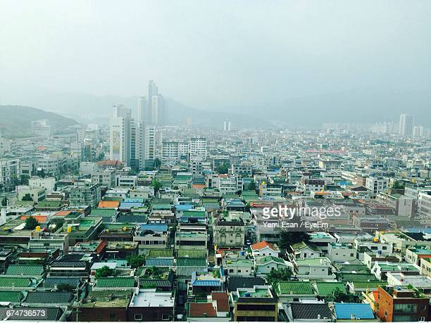 high angle view of buildings against sky in city - 大邱 ストックフォトと画像