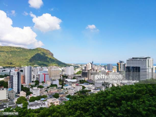 high angle view of buildings against sky - port louis stock photos and pictures