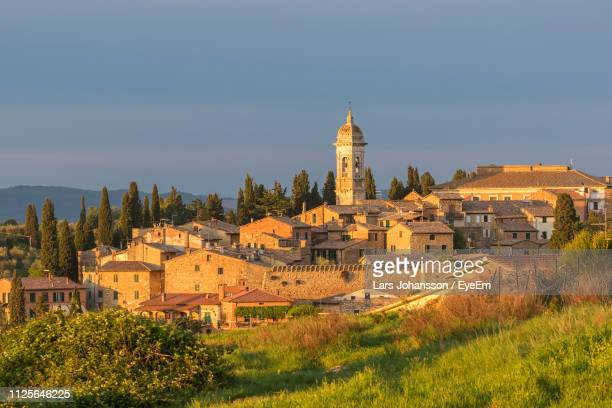 high angle view of buildings against sky - san quirico d'orcia stock pictures, royalty-free photos & images