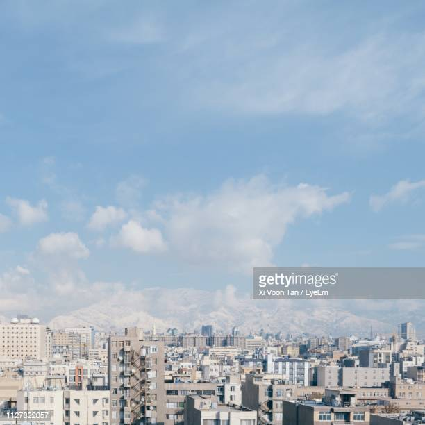 high angle view of buildings against sky - tehran stock pictures, royalty-free photos & images