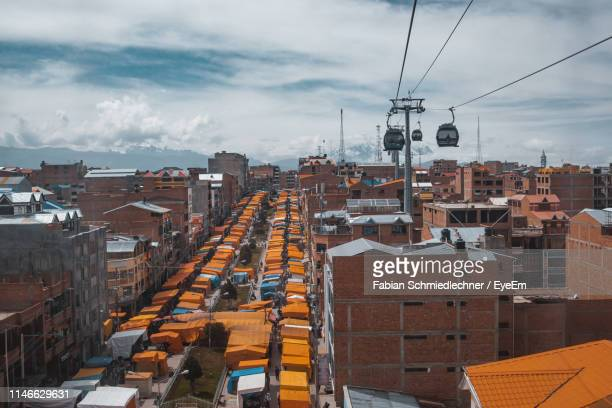 high angle view of buildings against sky - bolivien stock-fotos und bilder