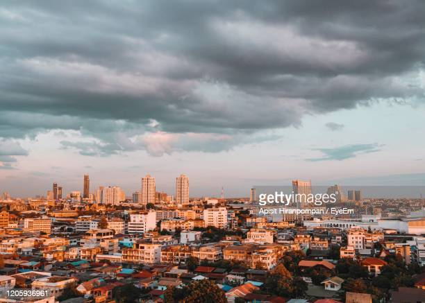 high angle view of buildings against sky - apisit hiranpornpan stock pictures, royalty-free photos & images