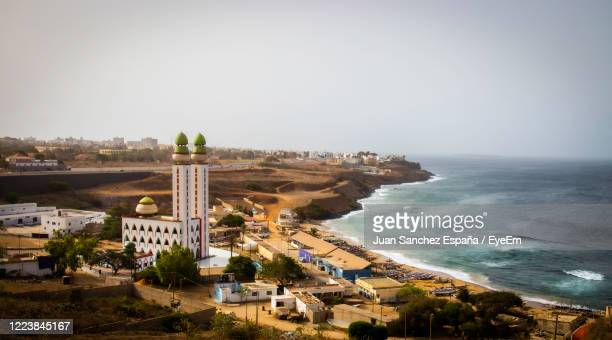high angle view of buildings against sky - dakar stock pictures, royalty-free photos & images