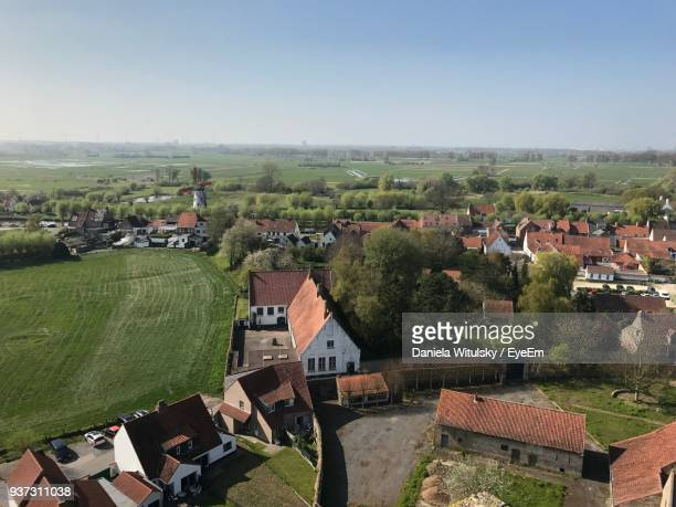 high angle view of buildings against sky - west flanders stock pictures, royalty-free photos & images