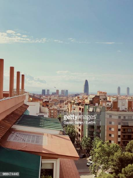 high angle view of buildings against sky - barcelona spain stock-fotos und bilder
