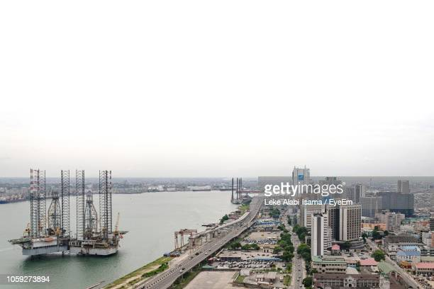 high angle view of buildings and city against sky - lagos nigeria photos et images de collection
