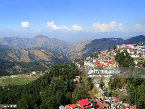 high angle view of buildings and mountains against sky - shimla stock pictures, royalty-free photos & images