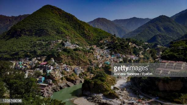 high angle view of buildings and mountains against sky - haridwar stock pictures, royalty-free photos & images