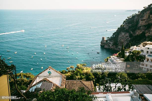 High Angle View Of Buildings And Rocky Mountains Against Sea At Positano