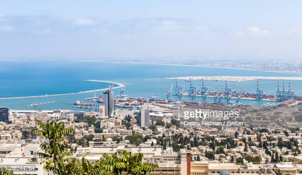 high angle view of buildings and sea against sky - haifa stock pictures, royalty-free photos & images
